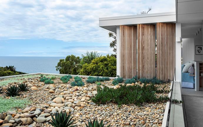 Three of the home's four bedrooms have direct access to the rooftop terrace, which was landscaped by Conzept Landscape Architects. The shutters are made from Fijian mahogany. Duell wall light, Modular Lighting.