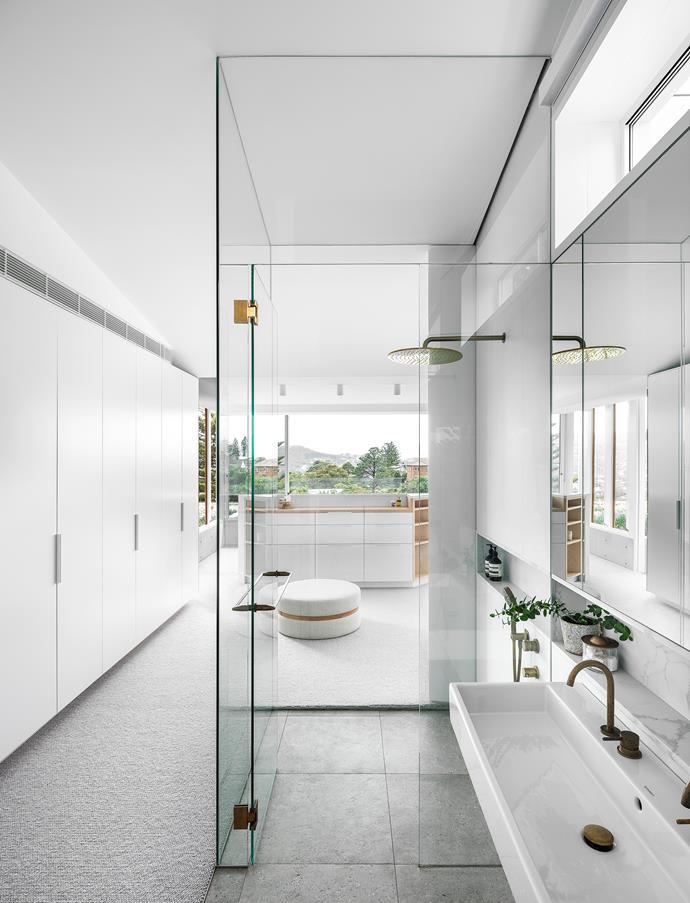 Aggregate II floor tiles, Skheme. Wall tiles, Exclusive Tiles. Talostone Calacatta Luxe niche. Basin and tapware, Sydney Tap & Bathroomware. Custom ottoman (at dressing table) by Kira & Kira.