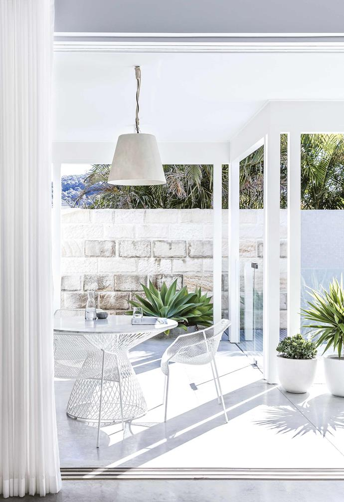 **Indoor-outdoor flow** The interior of the home connects seamlessly to the outdoor entertaining area courtesy of sliding glass doors.