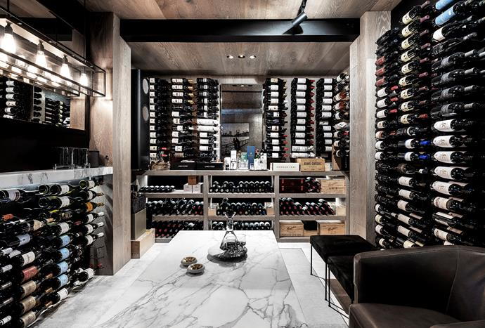 The wine cellar, designed by Matt and Ellen, can accommodate up to 1100 bottles. Wine racks and temperature control unit, MacPhee's. Engineered-timber cladding, European Timber Floors. Seating, MCM House. Calacatta marble bench and shelf, Harmony Stone Gallery. Tom Dixon decanter and glassware, Manyara Home. Lighting, Koda Lighting.