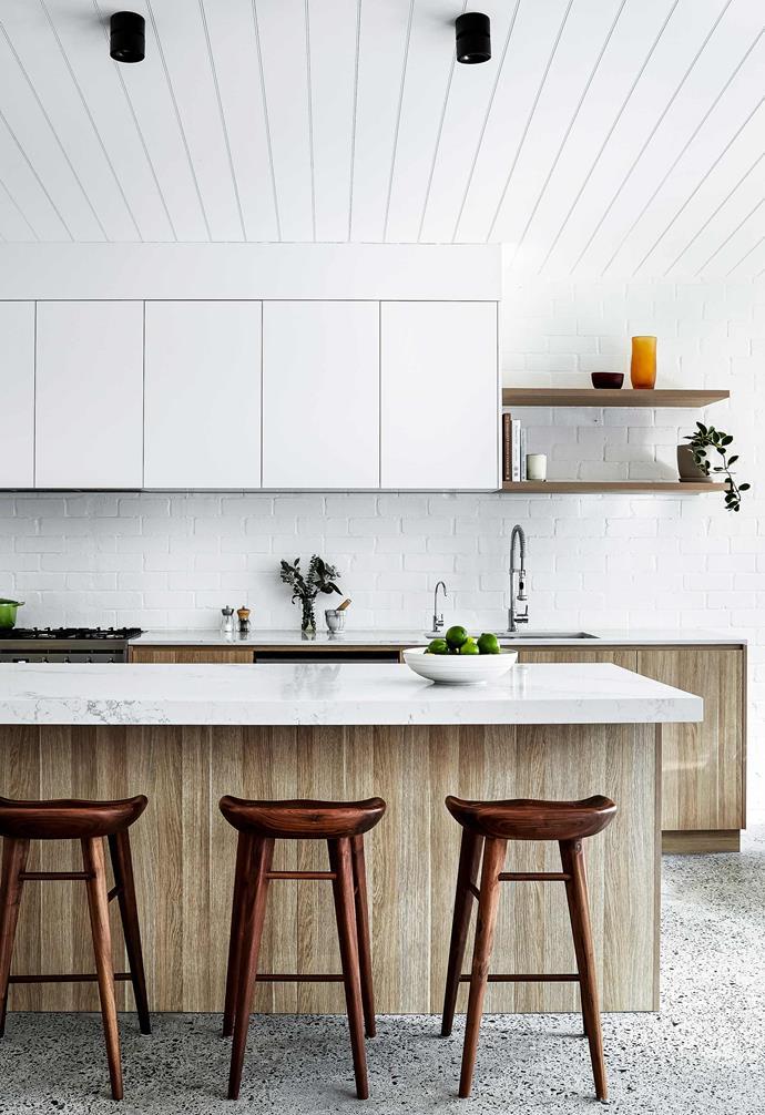 "**Kitchen** Statuario Maximus [Caesarstone](https://www.caesarstone.com.au/|target=""_blank""|rel=""nofollow"") are paired with [Polytec](https://www.polytec.com.au/|target=""_blank""|rel=""nofollow"") cabinetry in Natural Oak Ravine. Upper cupboards in [Dulux](https://www.dulux.com.au/|target=""_blank""|rel=""nofollow"") White Exchange Quarter satin polyurethane. Handles, [Kethy](https://www.kethy.com.au/|target=""_blank""|rel=""nofollow""). Downlights, [Urban Lighting](https://urbanlighting.com.au/|target=""_blank""|rel=""nofollow""). Taburet bar stools, [Life Interiors](https://lifeinteriors.com.au/|target=""_blank""|rel=""nofollow"")."