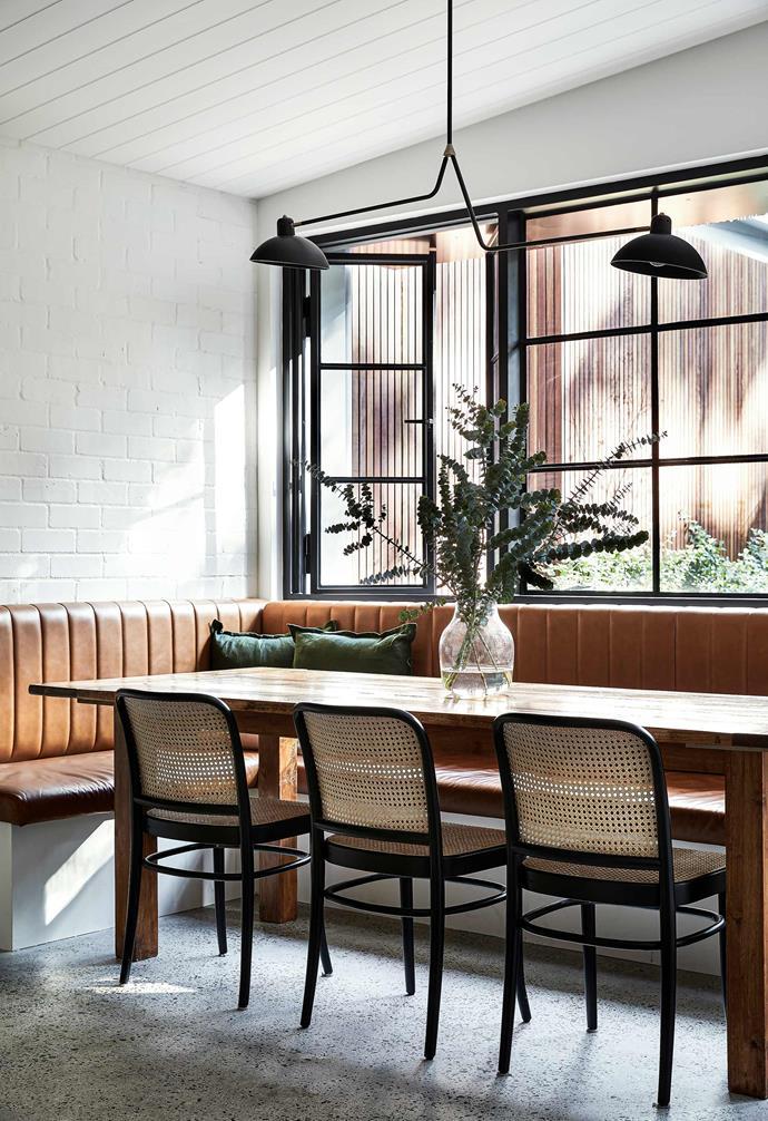 "**Dining nook** All the home's black steel framework is by [Steel Door](https://www.steeldoor.com.au/|target=""_blank""|rel=""nofollow""). The banquette is by architect [Raymond Panetta](https://www.raymondpanetta.com.au/|target=""_blank""|rel=""nofollow""). Leather upholstery, AAQT Upholstery. Dining table, [eBay](https://www.ebay.com.au/|target=""_blank""|rel=""nofollow""). Ton bentwood chairs, [Huset](https://www.huset.com.au/|target=""_blank""|rel=""nofollow""). Green cushions, [Target](https://www.target.com.au/. Lambert & Fils 'Waldorf' double suspension light, [Living Edge](https://livingedge.com.au/|target=""_blank""|rel=""nofollow"")."
