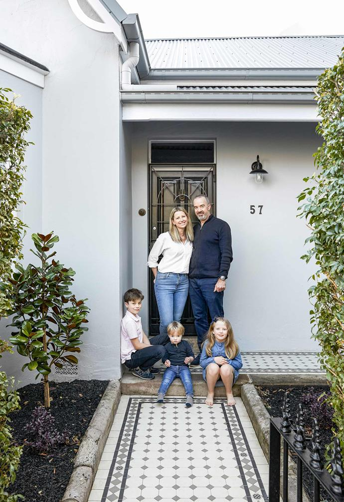 """**Exterior** Kristy and Kieren with children Alex, Isaac and Eliza. The paint colours are [Dulux](https://www.dulux.com.au/