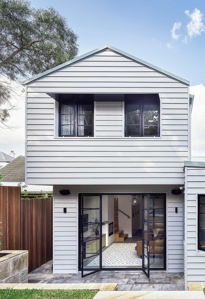 """**Extension** The new back and sides of the home are clad in 180mm-wide [James Hardie](https://www.jameshardie.com.au/