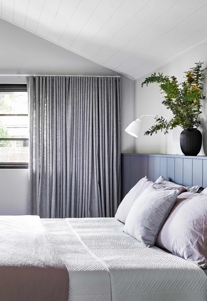 """**Main bedroom** """"I don't like headboards and wanted something different,"""" says Kristy of the custom 'shelf' in her room. The beadboard matches the ceiling and is painted [Dulux](https://www.dulux.com.au/