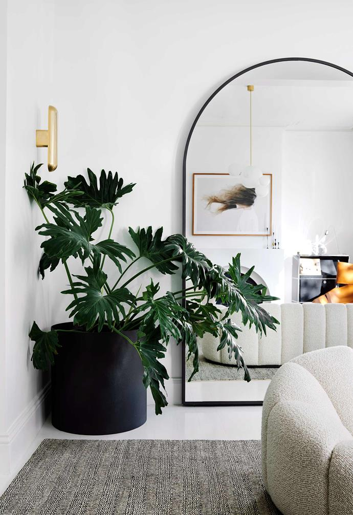 "**Quiet reflection**<br><br>A [large mirror](https://www.homestolove.com.au/designer-mirrors-21567|target=""_blank"") propped up against a wall or hung above a mantel can make a world of difference to a small or dark area. [The reflection of the room will make your space feel significantly bigger](https://www.homestolove.com.au/mirror-styles-16889