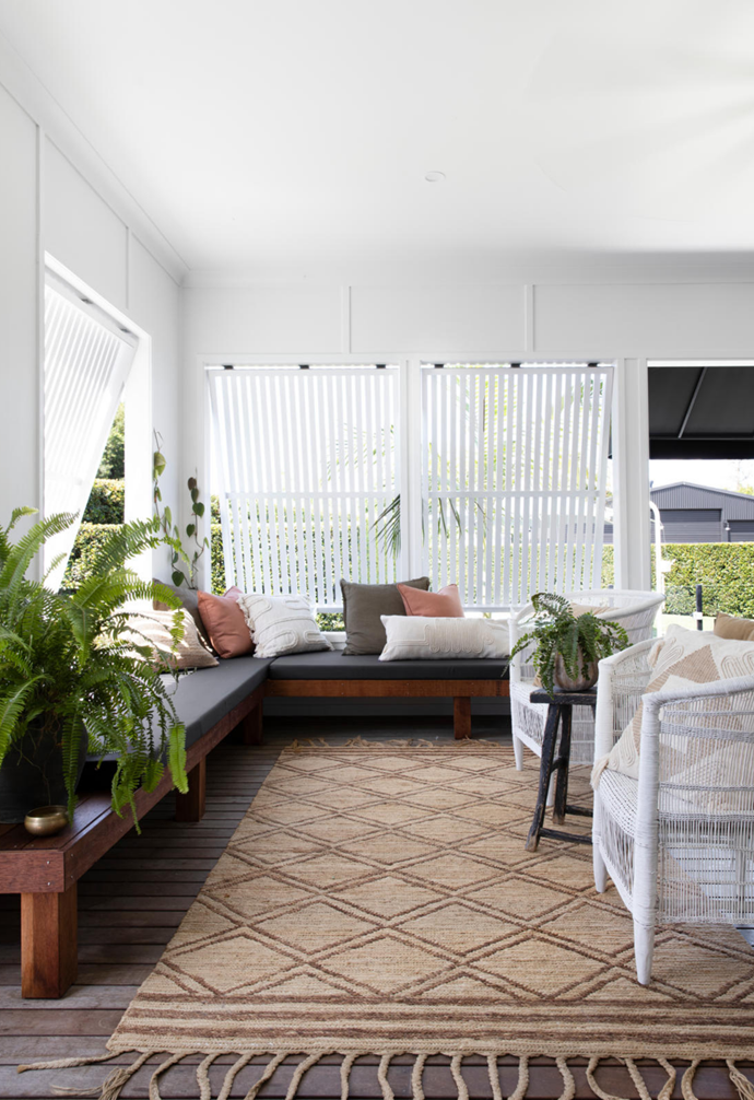 """Dappled light pours into the [outdoor room](https://www.homestolove.com.au/inviting-outdoor-room-ideas-19144
