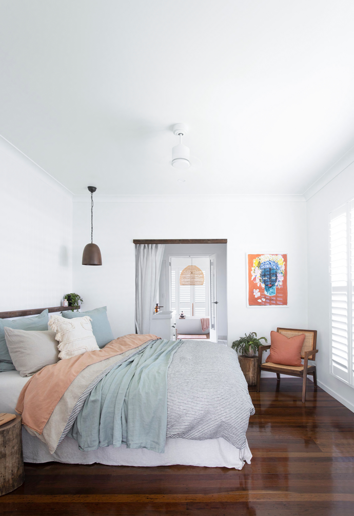 Dave and Jamie's bedroom steps it up a notch in five-star appeal with a bed dressed in luscious layers of I Love Linen, a colourful Jai Vasicek print on the white walls and, most significantly, easy access to the inspired bathhouse addition.