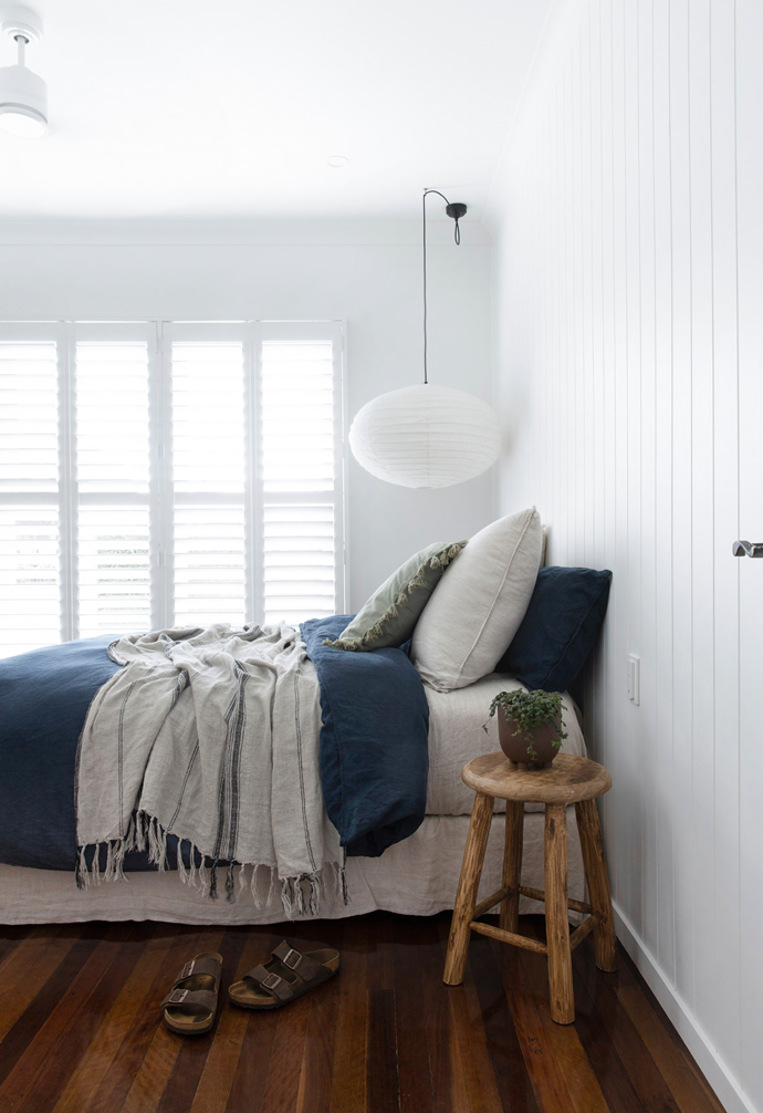 Simple and serene, Tom's room was updated with the same wall treatments; shutters installed on the windows to help modulate light and privacy. Adairs' Stonewashed linen is effortless and understated, so too is a pendant from The Society Inc and timber stool from Provincial Home Living.