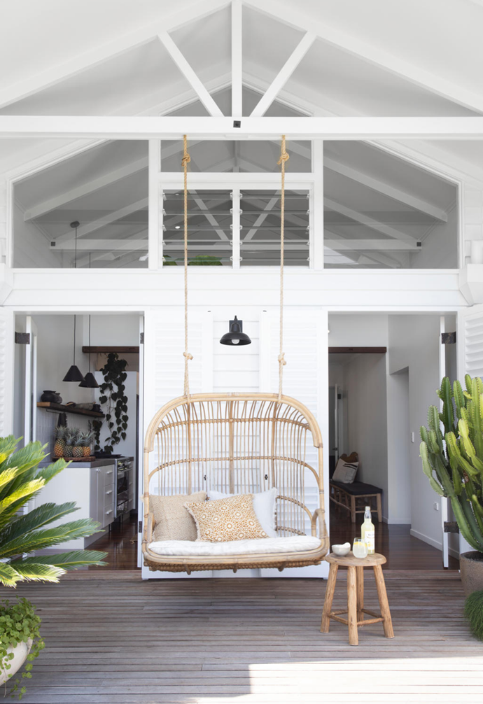 "Jamie: ""Our hanging chair from Byron Bay Hanging Chairs. It's framed beautifully by our front entrance."""