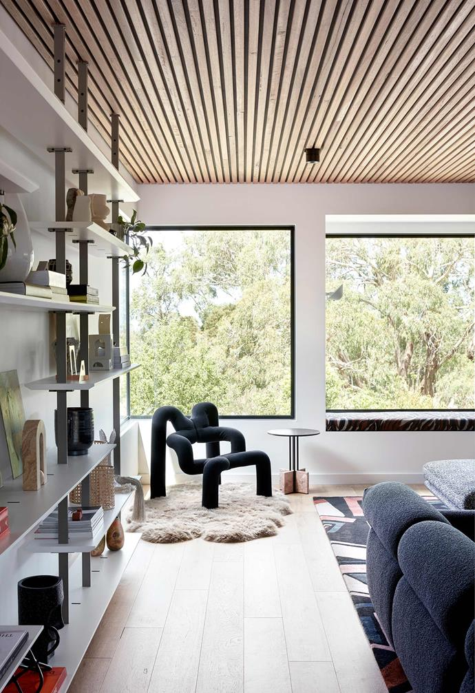 """**Strong hold** Large steel-framed windows capture the views in this [Mornington Peninsula home](https://www.homestolove.com.au/rammed-earth-home-red-hill-22099