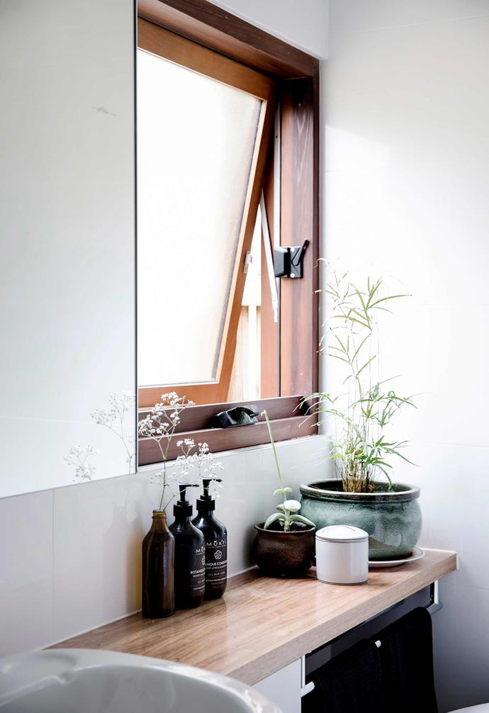 **Lean in** Solid timber awning windows are excellent for wet areas like bathrooms.