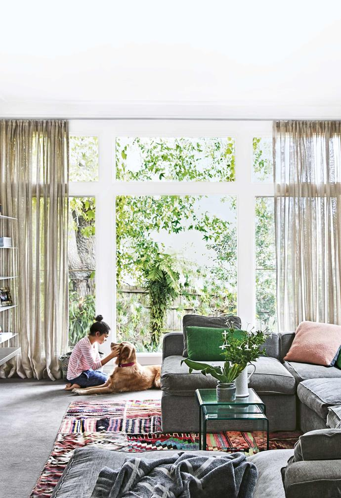 """**Sky high** Floor-to-ceiling windows can transform any living area into [a light-filled haven](https://www.homestolove.com.au/art-deco-house-melbourne-18506