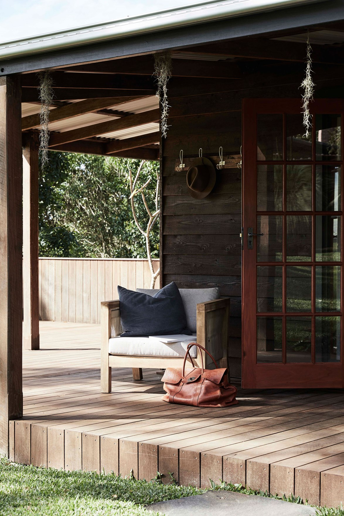 "At [The Perch](https://www.homestolove.com.au/the-perch-byron-bay-nsw-22311|target=""_blank""), a comfy armchair on the verandah invites visitors to enjoy a moment of quiet and observe the magical Byron Bay scenery."