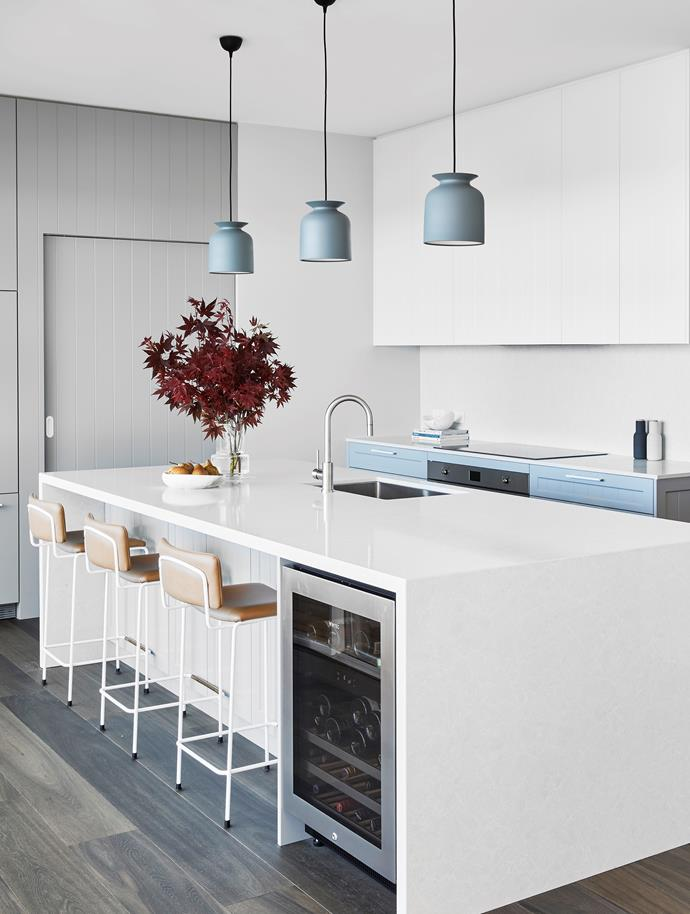 """A combination of white and soft grey imbues this Sydney kitchen with a sense of calm, which is also derived from having an abundance of storage. """"Everything has a place,"""" says interior designer Annie Bowen."""