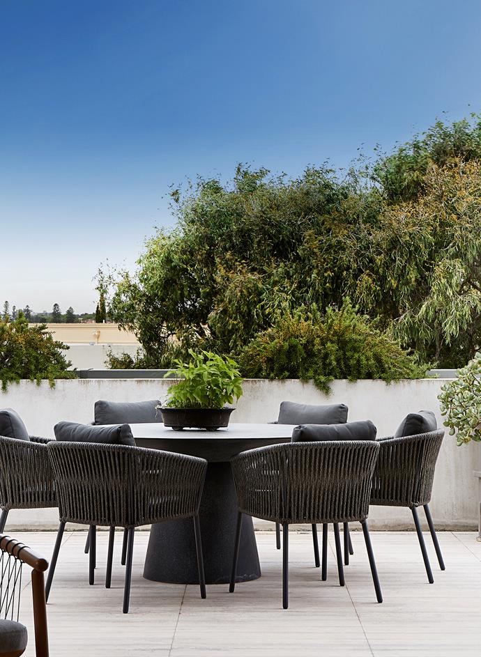 'Livorno' round dining table from GlobeWest and 'Catalina' outdoor chairs from Coco Republic.