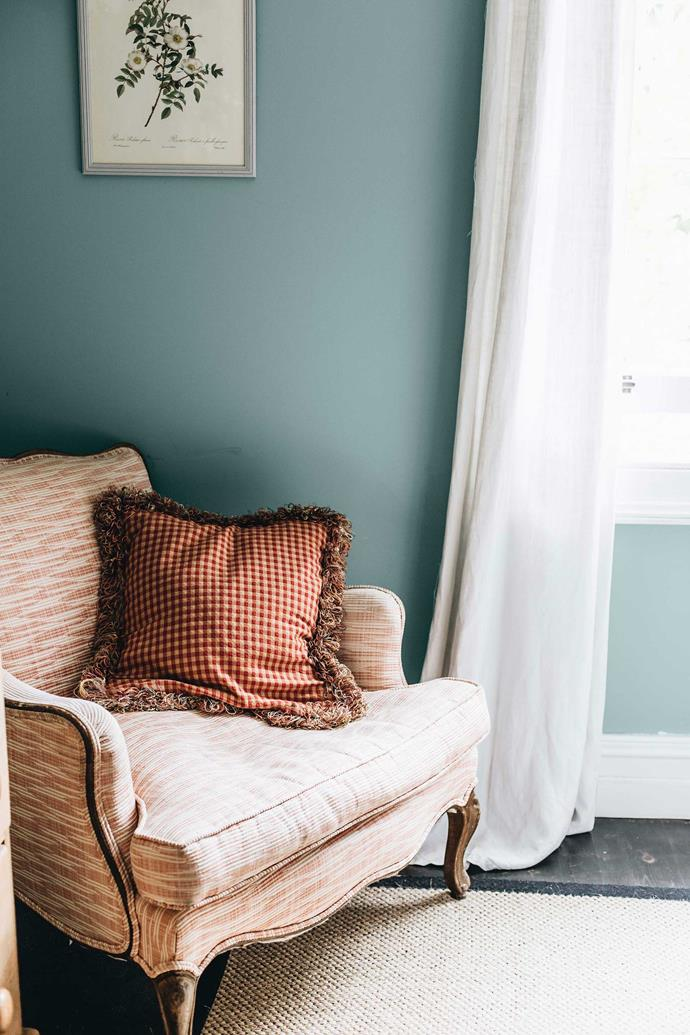 "An armchair in the bedroom. Jane loves furniture with history and a back story. ""People love vintage because it gives your home so much personality,"" she says."