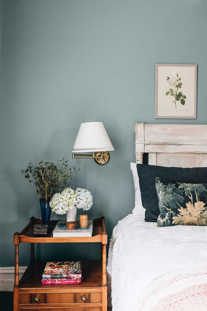 The bedroom with Farrow & Ball paint finish. Jane loves their soft colours, which add an English gentleness to the house. Despite having a shop full of treasures to choose from, Jane keeps her own collection to family heirlooms so others can also enjoy her fruits.