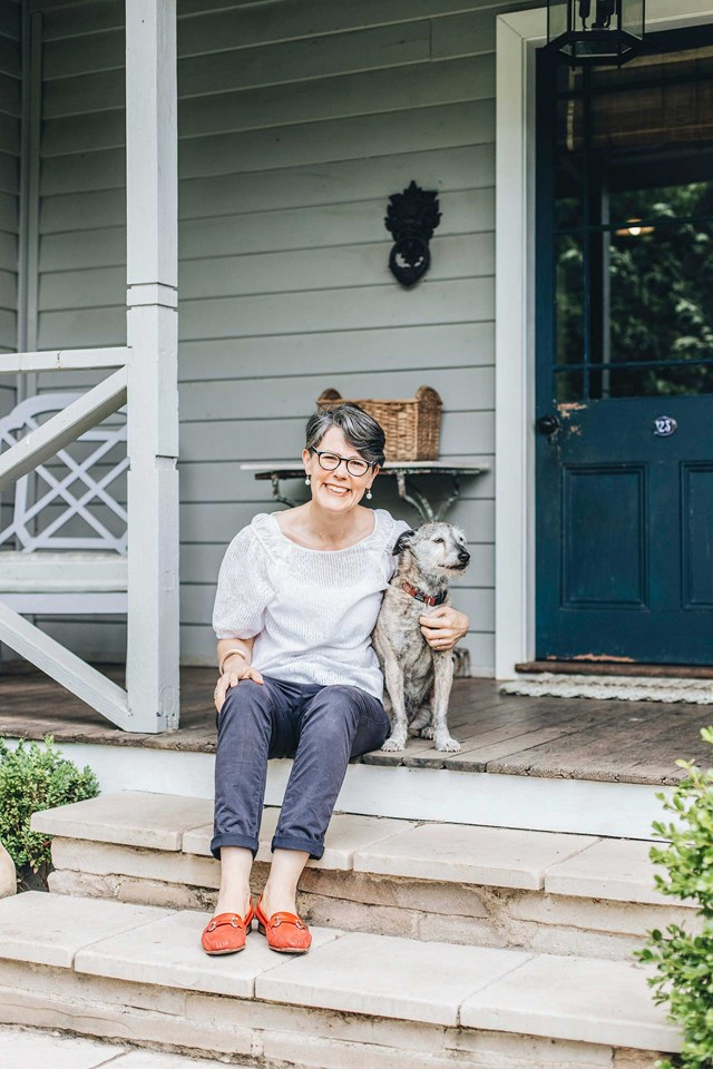Dirty Janes Bowral founder Jane Crowley on the front step of her home with dog, Jazzy.