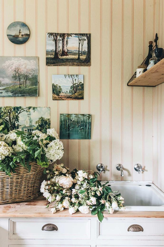 Jane's collection of vintage paintings decorates the laundry room.