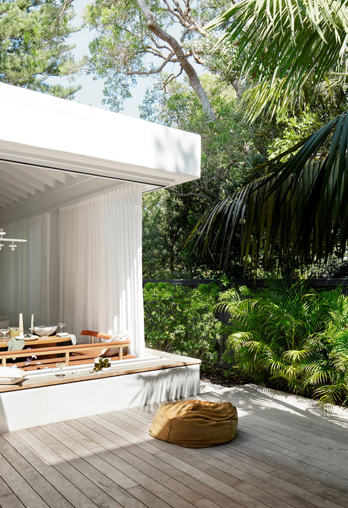 """The outdoor decking creates extra entertaining and living space for this [coastal Palm Beach home](https://www.homestolove.com.au/casual-christmas-decorating-ideas-22082