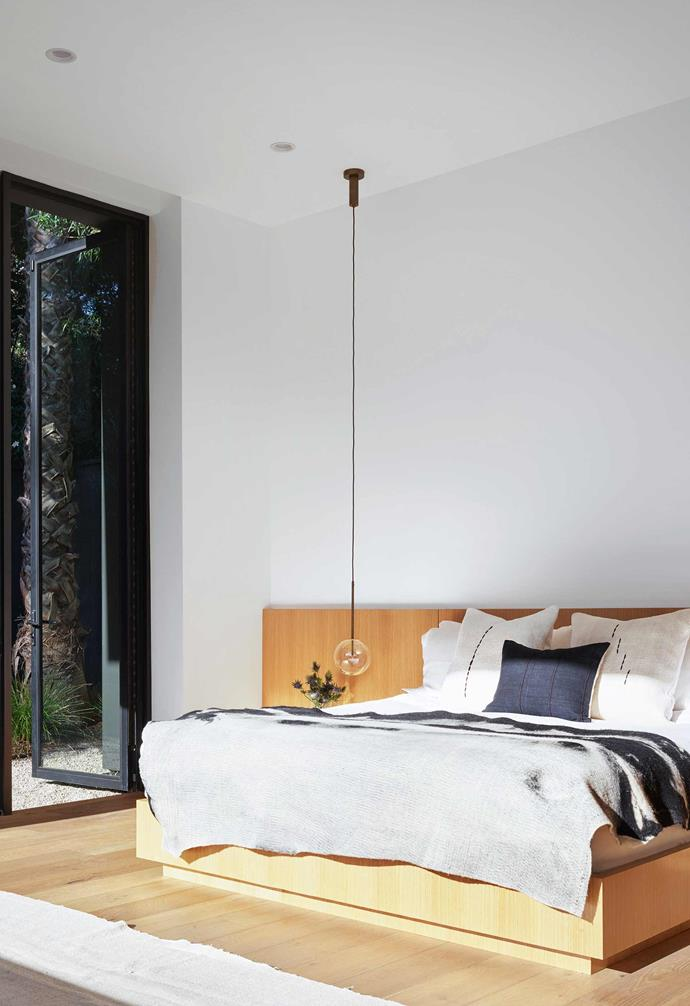 """**Main bedroom** """"In order to achieve a complete indoor/outdoor experience, there are no window dressings,"""" says David, who also designed the bed. Throw, [JG Switzer](https://jgswitzer.com/