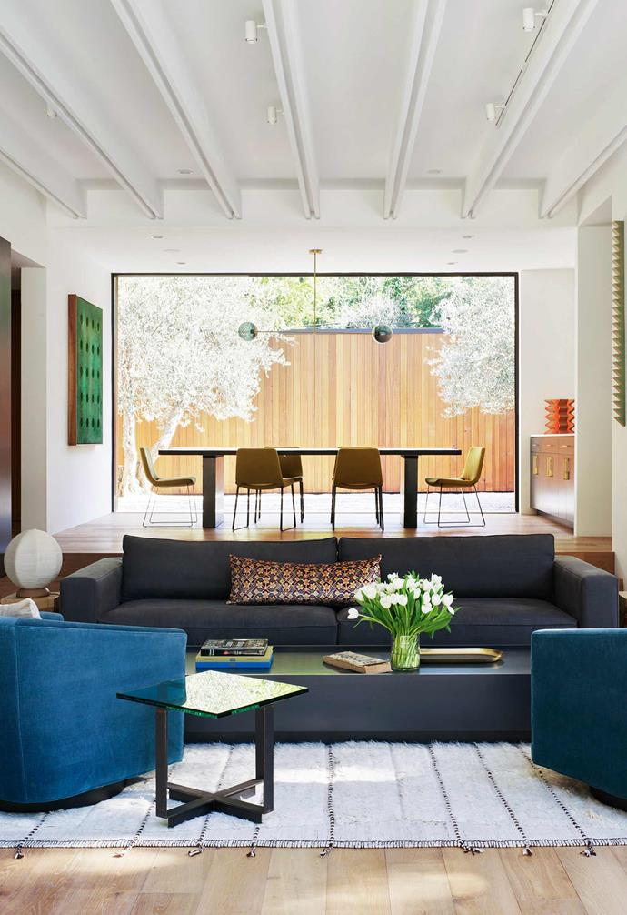 """**Living room/nook** As well as being a more formal space to entertain, this is where David likes to chill out. Eames lounge chair from [Design Within Reach](https://www.dwr.com/