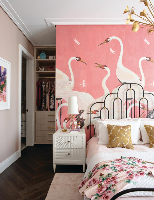 The owners' daughter can relax in her own pink paradise, thanks to Gucci 'Heron' print wallpaper. 'Deco' bed and 'Renwick' nightstand from Anthropologie. Visual Comfort 'Halcyon Accent' table lamp. Roberto Cavalli cushions from Amara. Artwork from Boyd Blue.