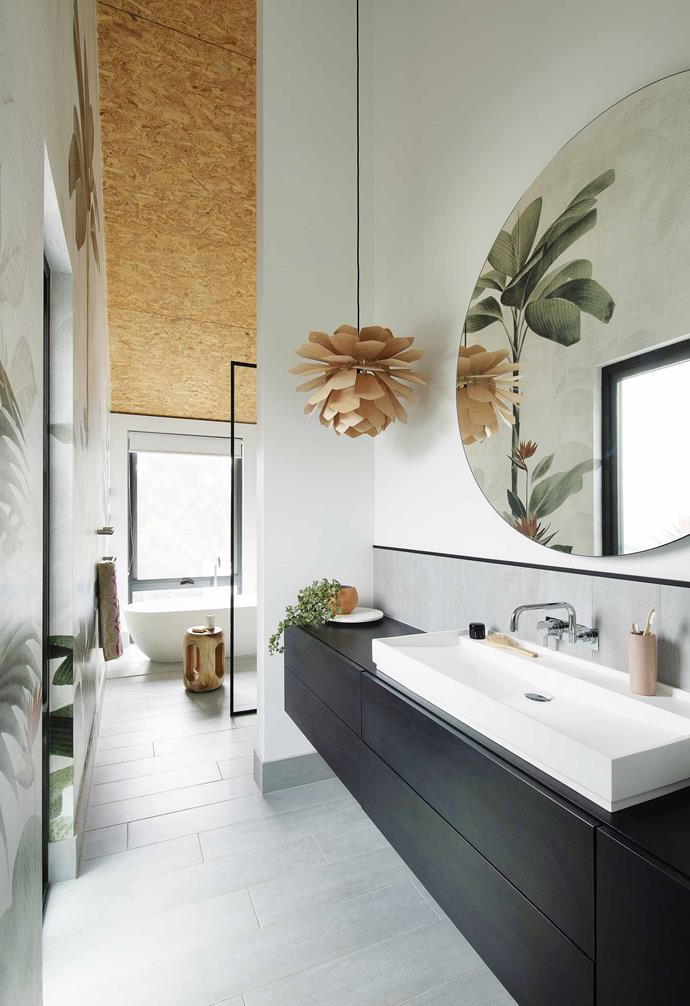 """A striking botanical wallpaper in the ensuite of this [barn-style home](https://www.homestolove.com.au/barn-style-house-19831