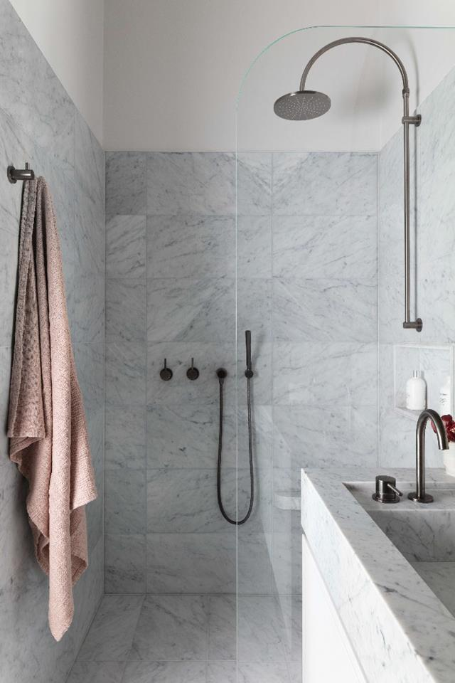 For continuity in this chic bathroom, Alexandra Donohoe of Decus specified the same Carrara marble for the floor tiles, wall tiles and vanity top, with the base colour matched to the paint on the joinery units and walls.