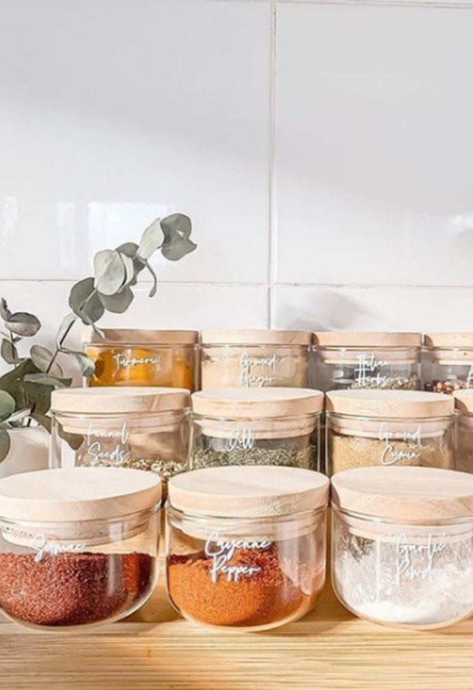 """**Storage style** <br><br> There are endless ways to personalise Kmart's handy storage jars, like these cursive labelled spice jars by [@ourlittlebudgethome](https://www.instagram.com/ourlittlebudgethome/