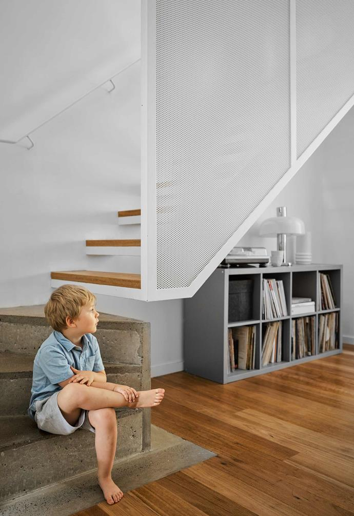 "**Staircase** Felix on the concrete steps leading to the steel-mesh-edged timber treads. Storage unit, [Ikea](https://www.ikea.com/au/en/|target=""_blank""