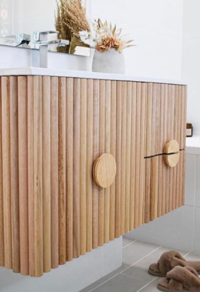 """**Handle hacks** <br><br> You would never guess that the handles on this stylish bathroom vanity were once lids, but that's exactly what [@kmarthack](https://www.instagram.com/kmarthack/