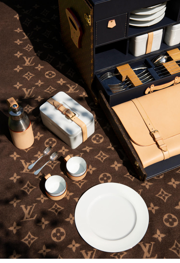 """**2021:** Featuring a tablecloth, napkins, cutlery, [porcelain dinnerware](https://www.homestolove.com.au/white-dinner-sets-13686 target=""""_blank"""") and more, the Malle Pique-Nique trunk is one of Louis Vuitton's extravagant new designs. The trunks weren't just for first class travel. Designed for the explorer Pierre Savorgnan de Brazza's expeditions in 1905, this camp bed folds into a Louis Vuitton trunk."""