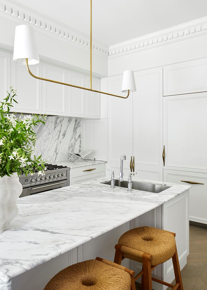 """Classicism is met with a crisp, modern sensibility in this kitchen by interior architect Phoebe Nicol. """"The room sits within a Victorian terrace, so we wanted to explore a subtle pairing of traditional joinery techniques with contemporary materials,"""" says Phoebe. By being generous in her specification of Statuario marble for both the benchtops and the splashback, Phoebe has deftly underlined the sophistication of this space."""