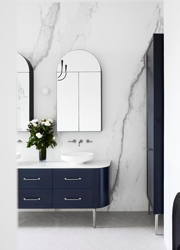 """With its sweeping spans of marble, the master ensuite offers up a beautiful combination of classical style and contemporary design. """"The custom-designed vanity legs by Daniel Barbera were chosen as a classic and elegant style that would be in keeping with the period of the home, but not be too bulky within the space – it's about balancing the volumes,"""" says architect and interior designer Melanie Beynon who worked alongside colleague, Alis Garlick."""
