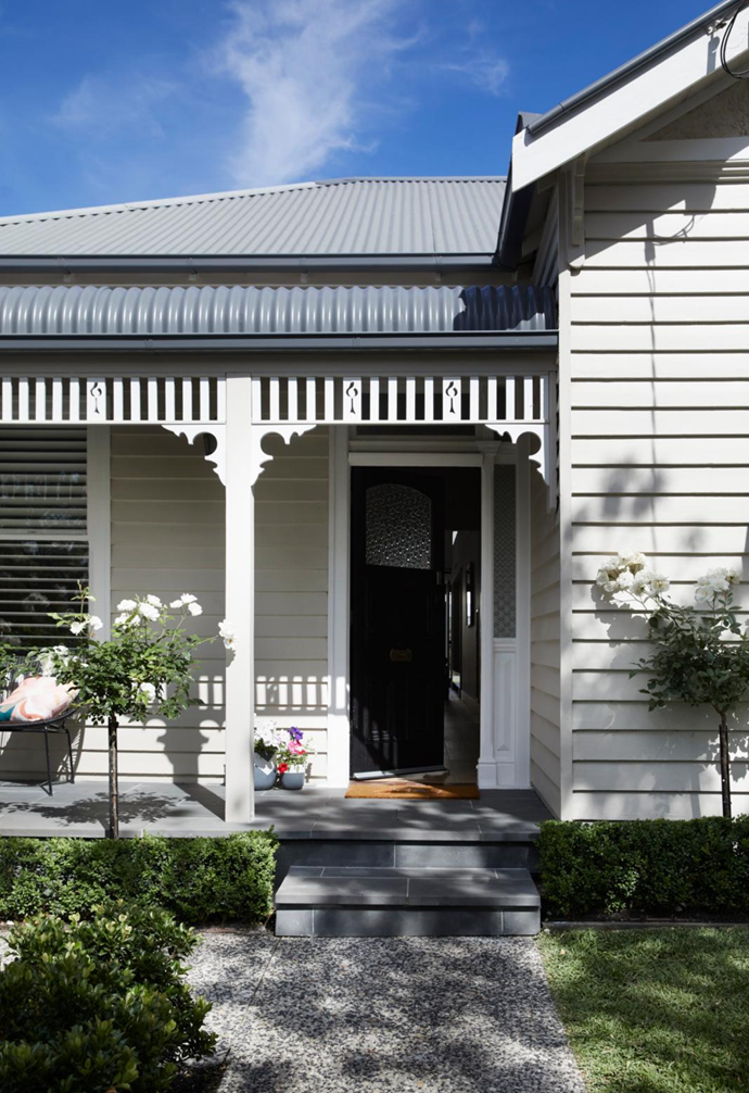 """Homeowners Gemma, a public relations consultant, and husband Dale, a builder, plus their young sons Hugo, three, and Angus, one,  love nothing more than welcoming family and friends to their beautifully reborn home in Melbourne's south-eastern suburbs. Flowering white roses and English box hedges grace the entrance, imbuing the garden with a traditional quality that is perfectly in keeping with the home's classic Edwardian facade. """"It's come together very well,"""" says Dale of the garden that he and his dad created together."""