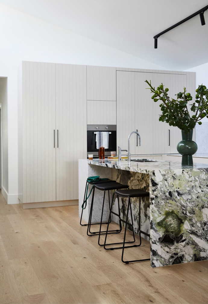 """One of Gemma and Dale favourite features is the kitchen's island bench in Ice Green marble from Signorino.  'Ardent' stools from Relax House create a contrast to the island's Ice Green marble and Carrara marble on the rear bench and splashback, and mirror the inky-toned custom rangehood box from The Melbourne Joiner. For a similar mixer with a pull-out option, try Hansgrohe's 'Talis M54' model. The large green vessel on the [island bench](https://www.homestolove.com.au/15-game-changing-kitchen-islands-for-your-renovation-13253