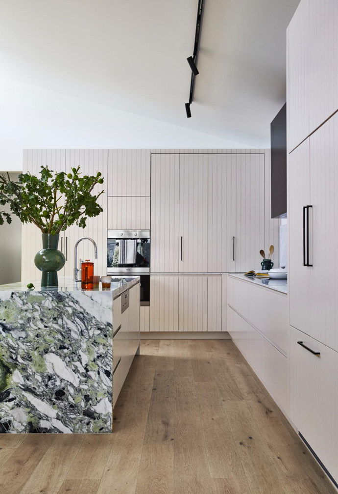 Appliances have been cleverly tucked away behind fold-out doors in the kitchen.
