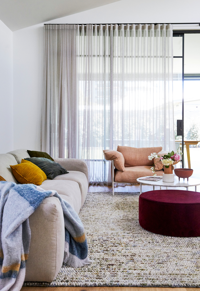 Curtains by HBS Blinds and Curtains brings a serene sense to the living room.