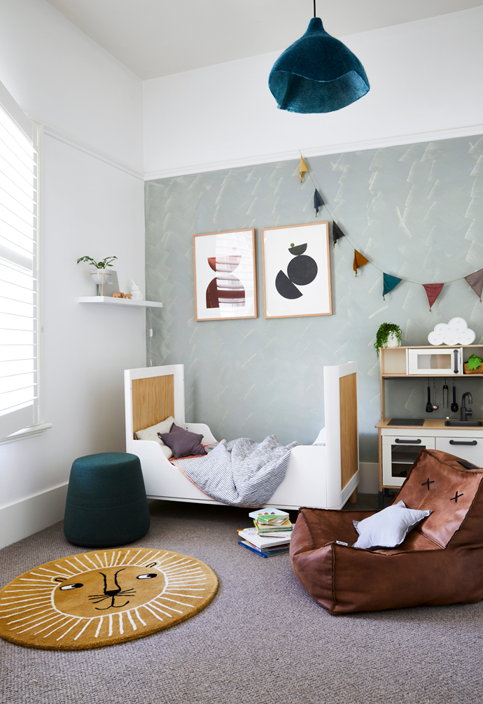 Hugo's bedroom features a sweet artwork by Bobby Clark. On the floor is an Oyoy Lion Rug from Leo & Bella.