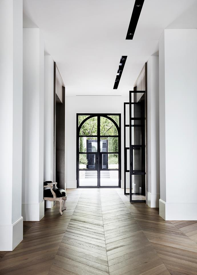 "A muted palette of alternating black and white rooms lends a pleasing rhythm to this [stylishly understated house](https://www.homestolove.com.au/melbourne-home-with-french-and-belgian-influence-6435|target=""_blank""). Steel doors designed by Dylan Farrell and fabricated by Fido Projects and Steel Window Design."
