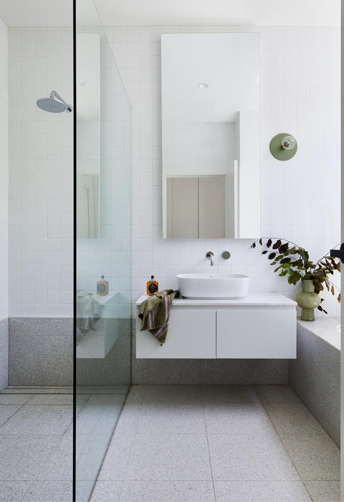 The family bathroom showcases terrazzo and Carrara marble.
