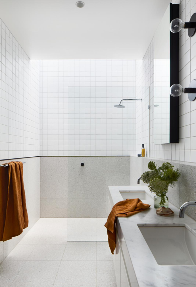 """Above the shower is what Gemma describes as an """"enormous"""" skylight that allows daylight to stream into the couple's ensuite, which comes complete with double basins and underfloor heating for the cooler months."""