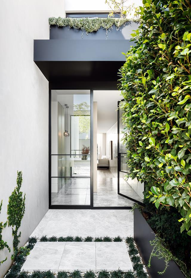 "Clever planning and a refined materials palette have resulted in this [contemporary home](https://www.homestolove.com.au/modern-yet-timeless-home-built-on-narrow-site-toorak-22228|target=""_blank"") being flooded with natural light. A double-frame steel front door creates a chic entrance and assists in creating a brightly-lit abode."