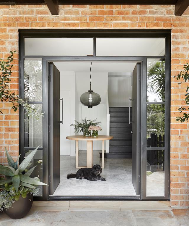 "The existing front door of this [family home](https://www.homestolove.com.au/family-home-modern-refresh-sydney-21886|target=""_blank"")  was replaced with a striking pair of timber ones, and framed in glass in order to flood the foyer with light."