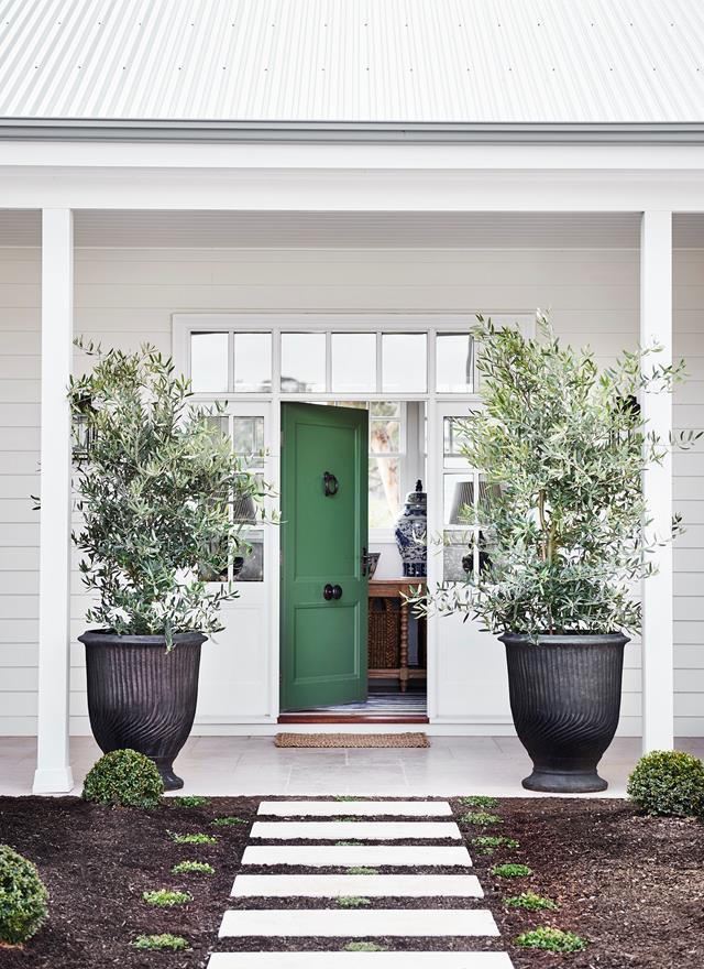 "This beautiful [modern Australian farmhouse](https://www.homestolove.com.au/modern-australian-farmhouse-design-21558|target=""_blank"") in the Macedon Ranges is an oasis named in honour of Banjo Patterson. The elegant front door is painted in Porter's Paints 'Bayleaf'."