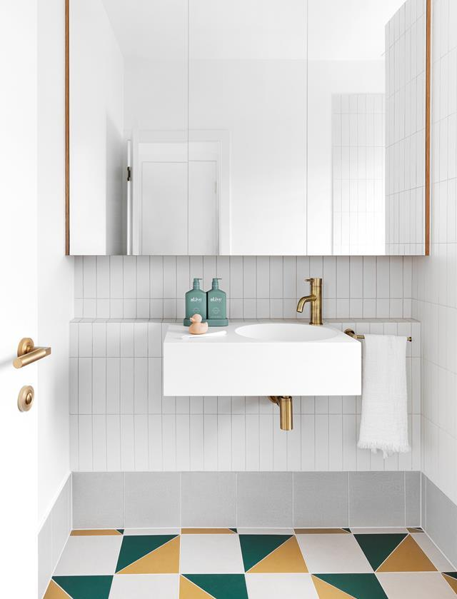 """Lively green, grey and gold floor tiles are a colourful surprise in this renovated [1950s Queenslander's](https://www.homestolove.com.au/renovated-1950s-queenslander-extension-22262