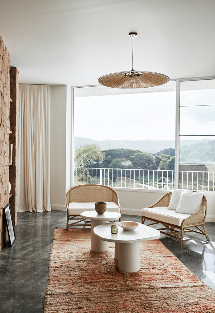 """A rug and tables from Tigmi Trading create an intimate zone within the open plan space of this [sprawling Byron Bay new-build](https://www.homestolove.com.au/new-build-byron-bay-hinterland-22186