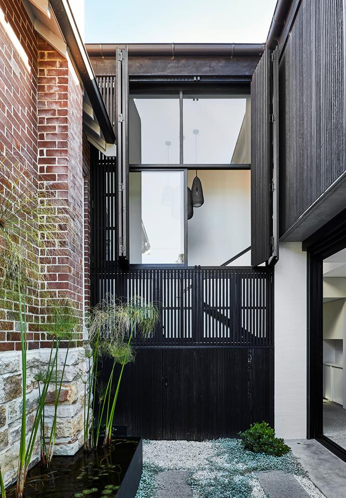 The glass 'link' and narrow courtyard between the old and new structures provides breathing space.